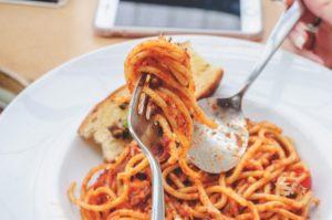 eat spaghetti twirled on fork