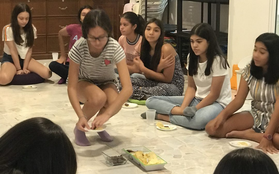 Young girls experiencing food and eating through the senses
