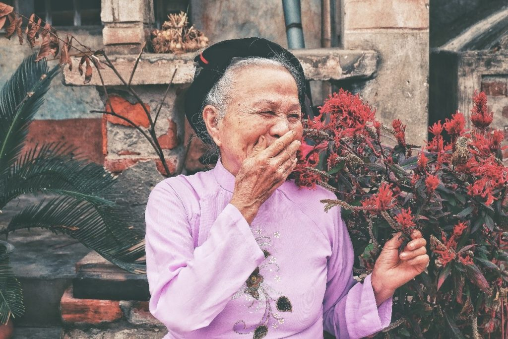 Elderly Chinese woman feeling emotions