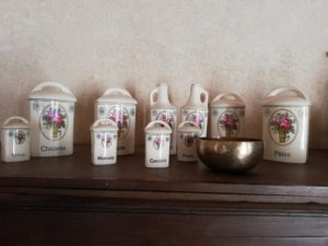 a row of small painted French vases