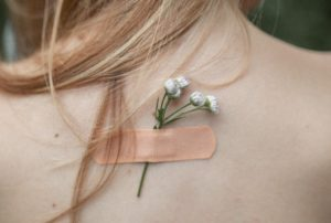 bandaid with flower on woman's back
